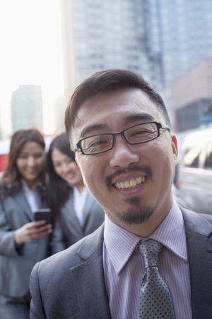 three day beard: Portrait of smiling businessman outdoors, Beijing   Stock Photo