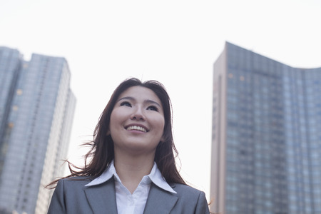 above 21: Portrait of young businesswoman outdoors, Beijing
