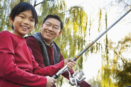 grandson: Grandfather and grandson fishing portrait