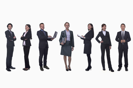 medium length: Medium group of business people in a row, portrait, full length, studio shot Stock Photo