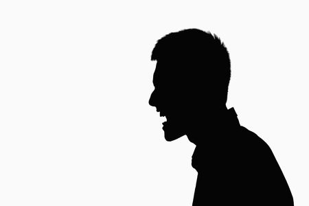 Silhouette of man screaming. photo