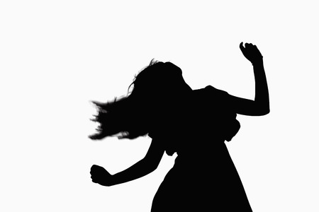 above 21: Silhouette of woman dancing. Stock Photo
