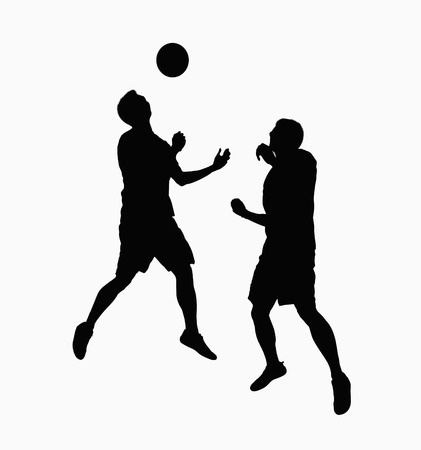 Silhouette of two soccer players fighting for ball. photo