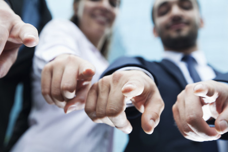 middle eastern ethnicity: Close-up of four business peoples fingers pointing at camera
