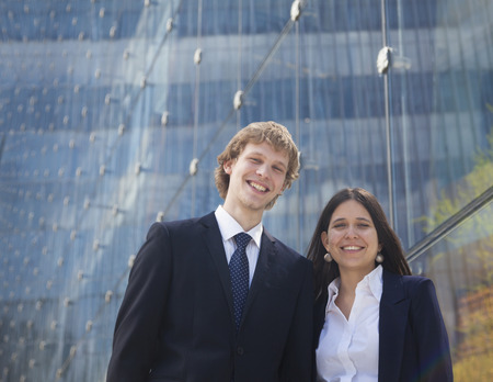 above 21: Portrait of two smiling young business people outdoors in Beijing, China