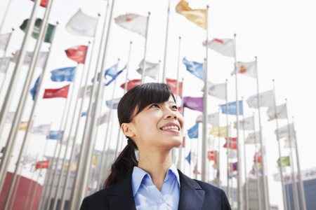 Young Businesswoman standing and smiling