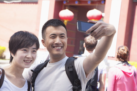 above 21: Young couple taking self portrait.