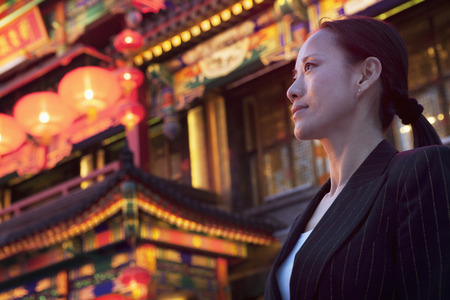 above 30: Businesswomen with Chinese architecture in background.