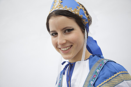 russian ethnicity caucasian: Portrait of young smiling woman in traditional clothing from Russia, studio shot