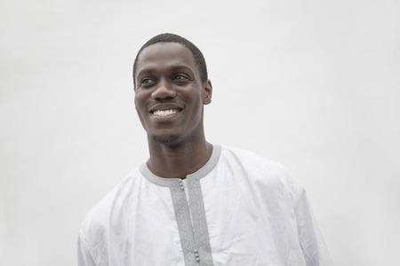 above 25: Portrait of young man in traditional African clothing, studio shot