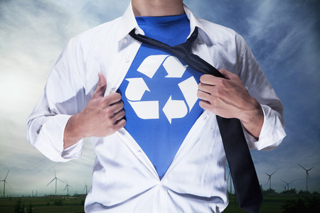 revealing: Businessman with open short revealing shirt with recycling symbol underneath Stock Photo