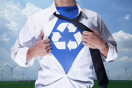 Businessman with open short revealing shirt with recycling symbol underneath Banco de Imagens