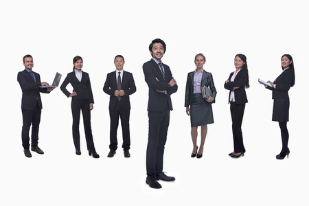 Medium group of business people in a row, portrait, full length, studio shot photo