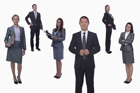 Medium group of smiling business people, portrait, full length, studio shot photo