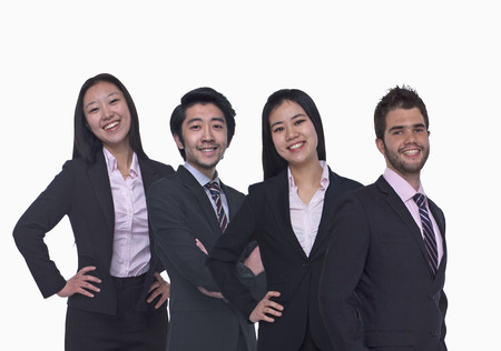 Portrait of four young business people looking at the camera, three quarter length, studio shot photo