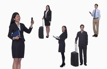 Group of business people working, taking photos, texting, studio shot, full length photo