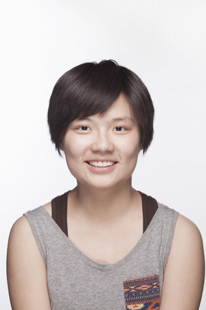 above 18: Portrait of young woman with short hair, studio shot