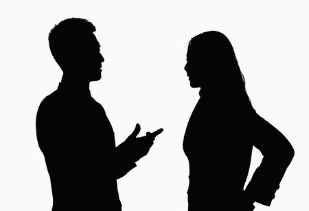 talking people: Silhouette of businessman and businesswoman talking. Stock Photo