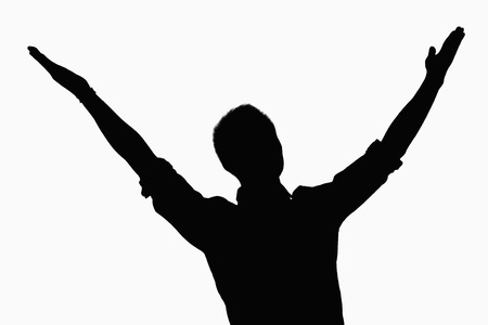 Silhouette of businessman with arms raised. photo