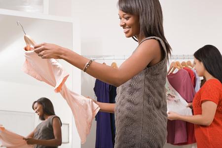clothes shop: Women in clothes shop Stock Photo