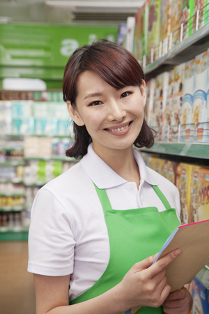 sales clerk: Portrait of Female Sales Clerk in a Supermarket