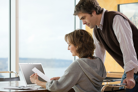 grown ups: A couple looking at paperwork