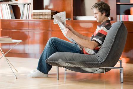 parlours: A man reading a newspaper