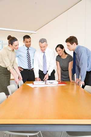 35 to 40 year olds: Five colleagues around a desk Stock Photo