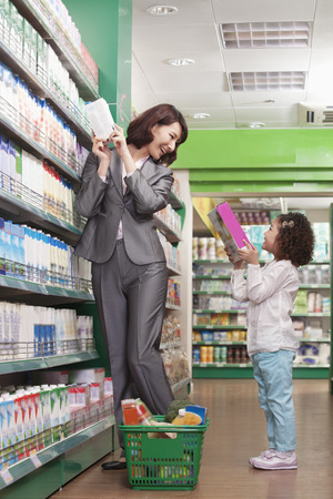 supermarket series: Mother and Daughter Having Fun in Supermarket