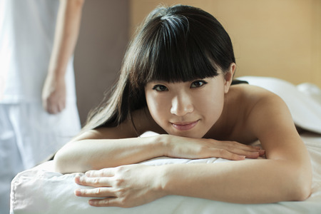 Young Woman Relaxing on Massage Table photo