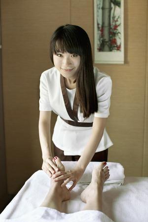 semi dress: Massage Therapist Massaging Feet
