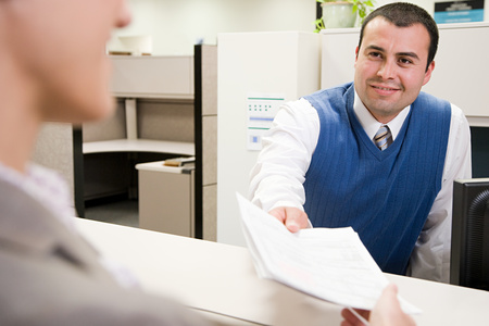 Man passing paper photo