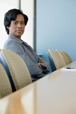 african american woman business: Businesswoman in boardroom