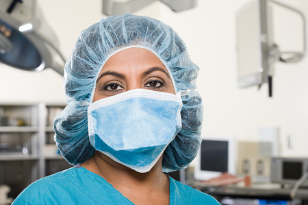 Surgeon in operating theatre Stock Photo