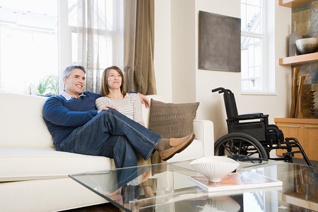 35 to 40 year olds: Couple relaxing in the living room Stock Photo