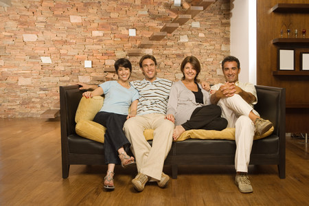 Grown up family on the sofa photo