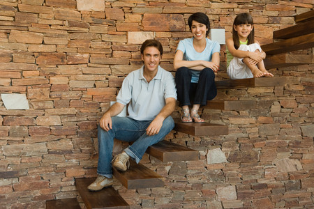 Family sitting on steps photo