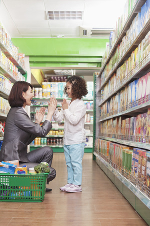 Mother and Daughter Playing in the Supermarket photo