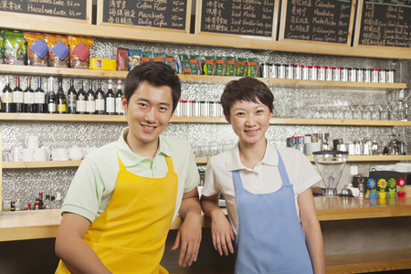 Portrait of two baristas at a coffee shop, Beijing
