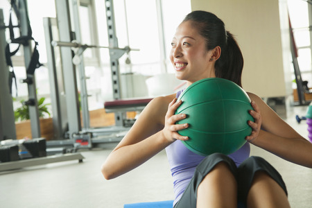 young woman exercising in the gym photo