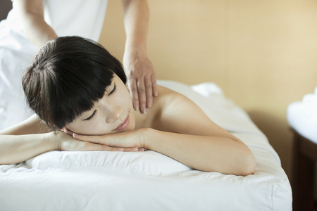 semi dress: Young Woman Receiving Massage Stock Photo
