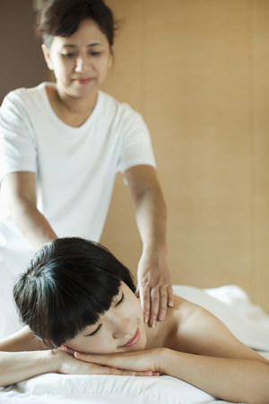 Receiving: Young Woman Receiving Massage Stock Photo