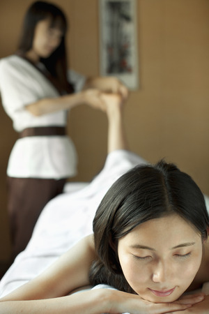 Massage Therapist Massaging Feet photo
