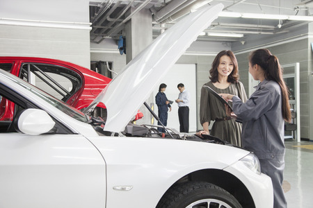 auto repair shop: Mechanics and Customers in Auto Repair Shop