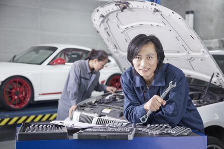 auto focus: Male Mechanic in Auto Repair Shop Stock Photo