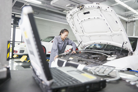 auto repair: Female Mechanic working in Auto Repair Shop Stock Photo