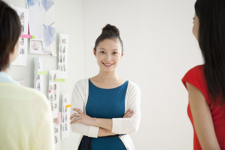 Portrait of Smiling Businesswoman in Creative Office photo