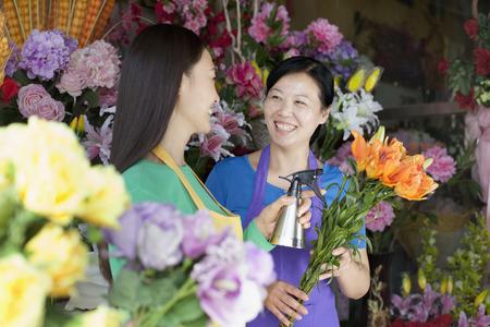beauty shop: Two Mature Women Working In Flower Shop