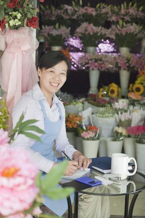 beauty shop: Florist Working In Flower Shop