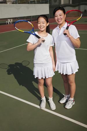 母と娘のテニス 写真素材